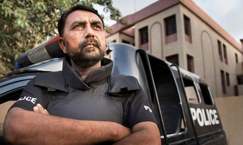 """""""I made a decision at that time, that I will enter the police and will show them that even if my father was not able to do this job, I will be able to do it,"""" says Abid Farooq.—Photo by Nadir Siddiqui"""