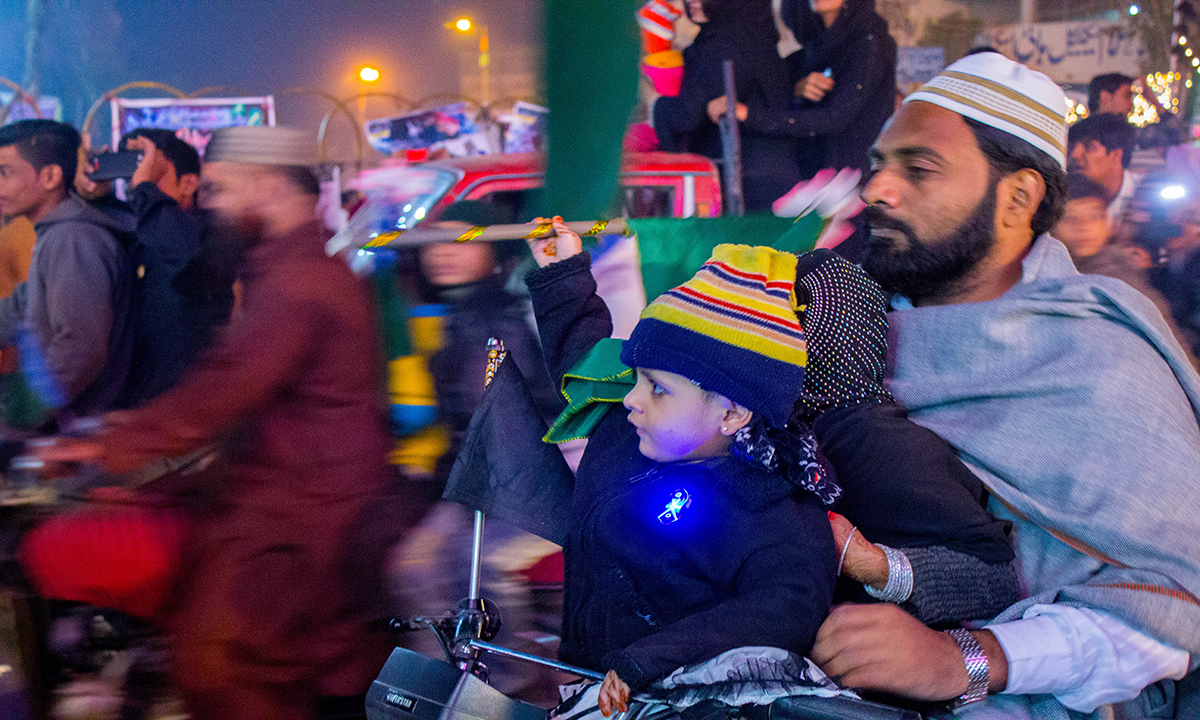 A family sets out to watch the decorations and lighting. — Muhammad Umar