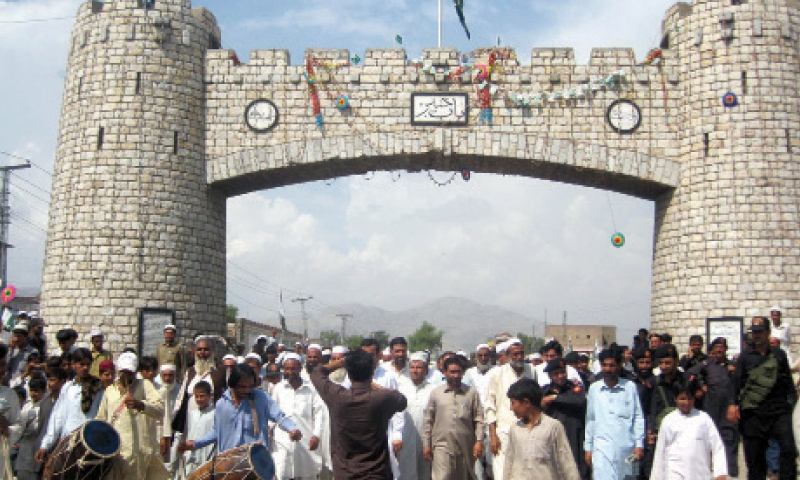 Tribesmen celebrate the promulgation of presidential ordinance for reforms in FCR at Bab-i-Khyber, Jamrud, almost three and a half years ago. —File photo