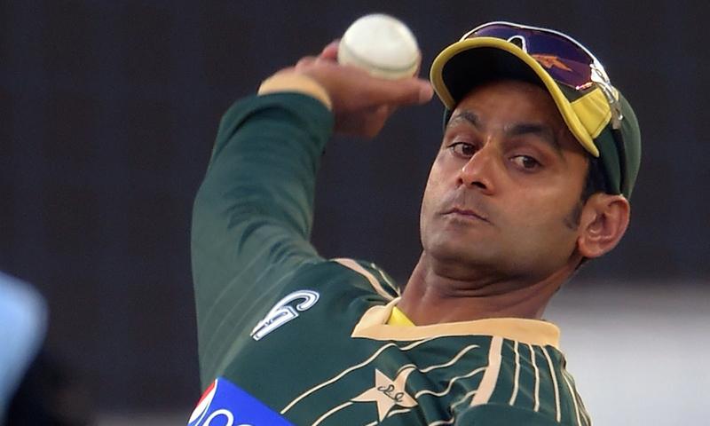Mohammad Hafeez bowls during a net practice session at Dubai International Stadium in Dubai. — AFP/File