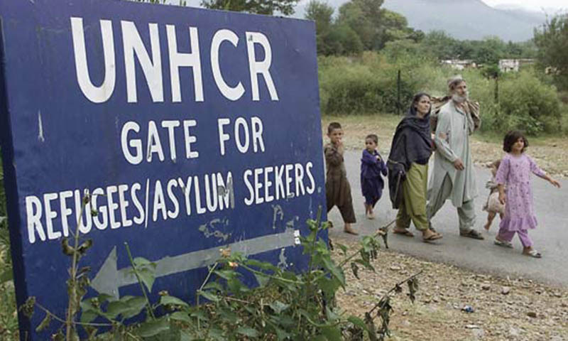 An Afghan refugee family walks to the United Nations High Commissioner for Refugees (UNHCR) headquarters in Islamabad. — Reuters/File
