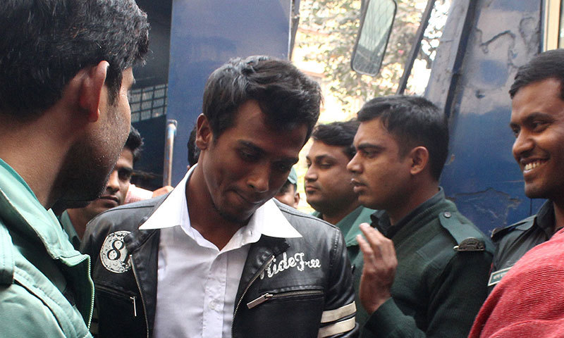 Bangladeshi cricketer Rubel Hossain (C), who has been named in the country's World Cup squad, is led away after being remanded in custody after his bail plea was rejected following allegations that he raped an actress in Dhaka on January 8, 2015. — AFP