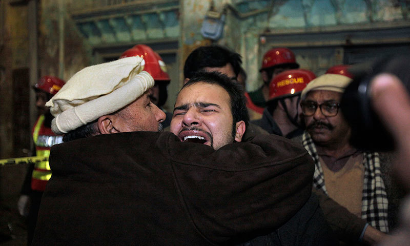 A Shia Muslim mourns over the death of his family member at the site of a blast in Rawalpindi on Jan 9, 2015. – AP
