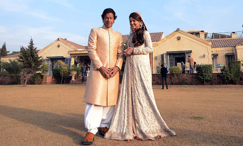 In this handout photograph released by the PTI, Imran Khan and new wife Reham Khan pose for a photograph during their wedding ceremony at his house in Islamabad. —AFP