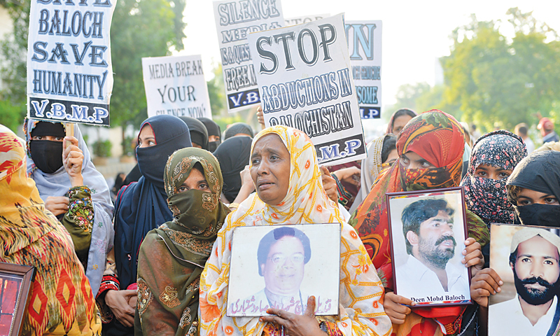 Relatives of missing persons demonstrating outside the press club in Karachi on Nov 22, 2013. — White Star