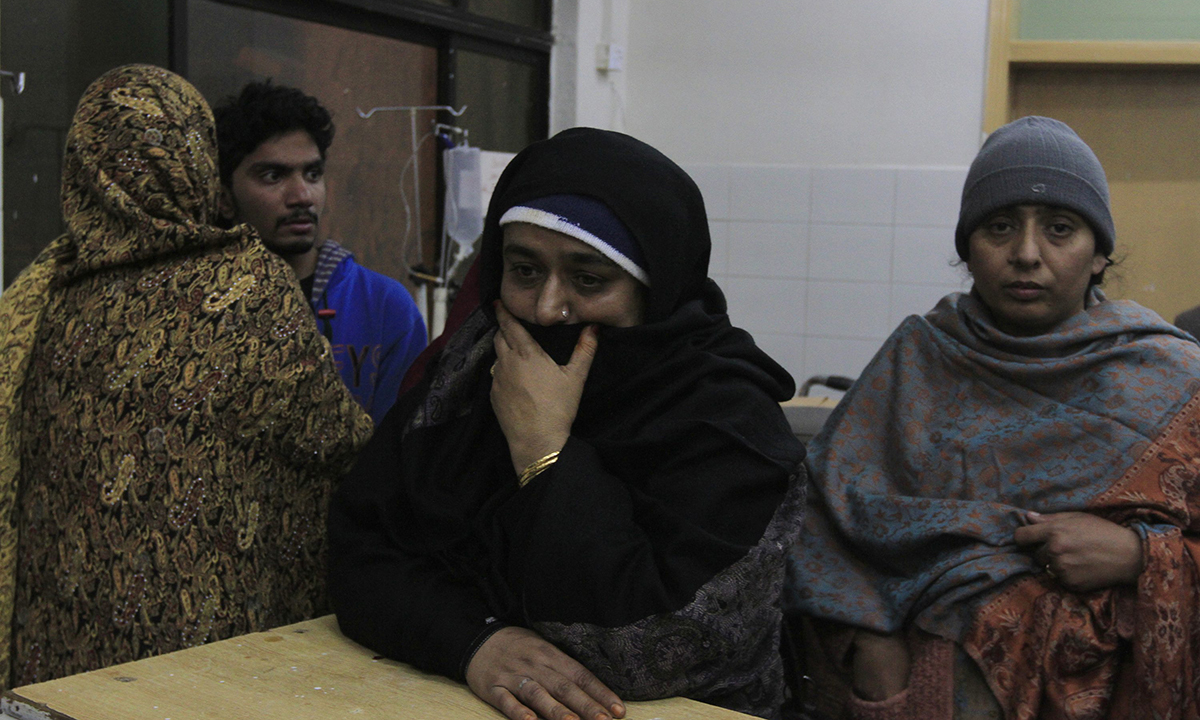A woman reacts after seeing her relative at a hospital, who was wounded in an attack in Rawalpindi. — Reuters