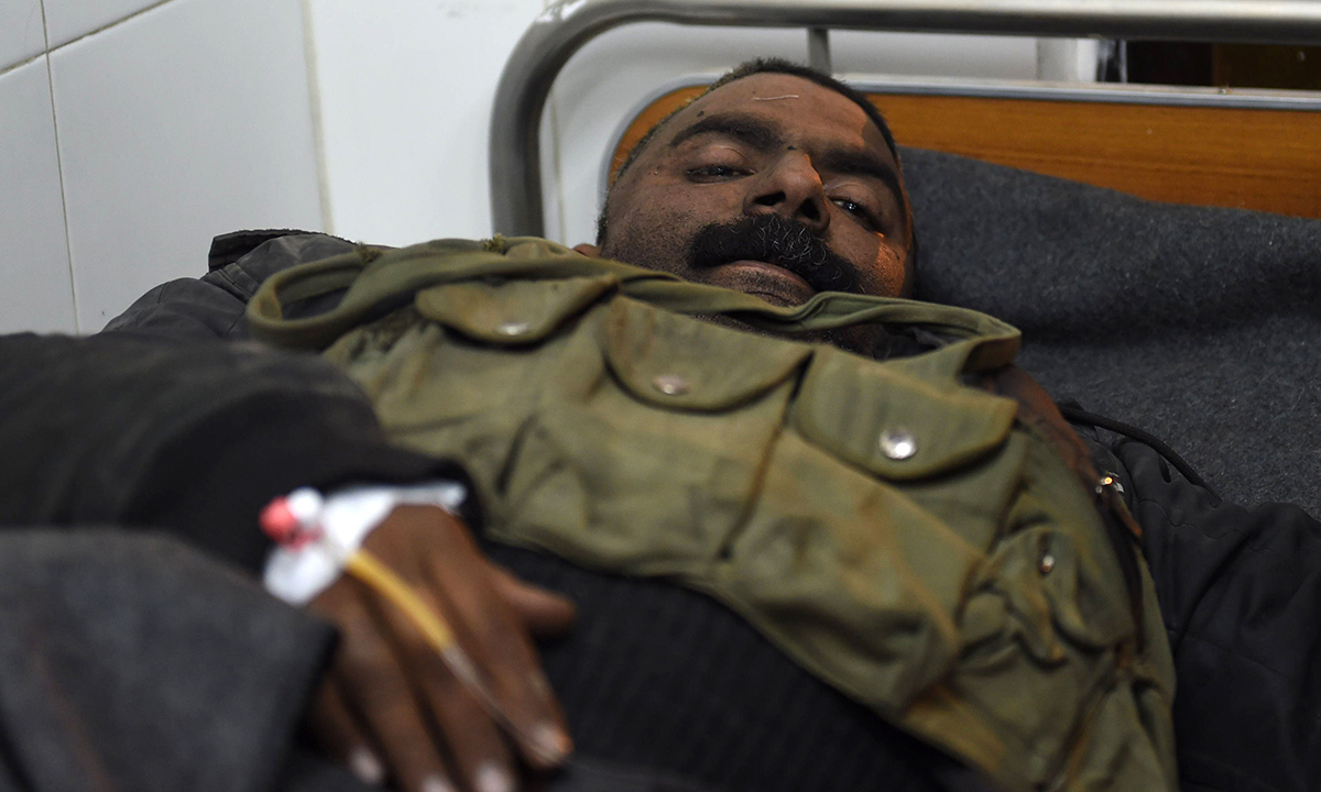 An injured policeman rests in hospital after treatment. — AFP