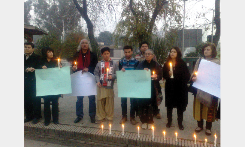 Civil society activists hold a vigil on the second death anniversary of Irfan Ali Khudi on Saturday.
