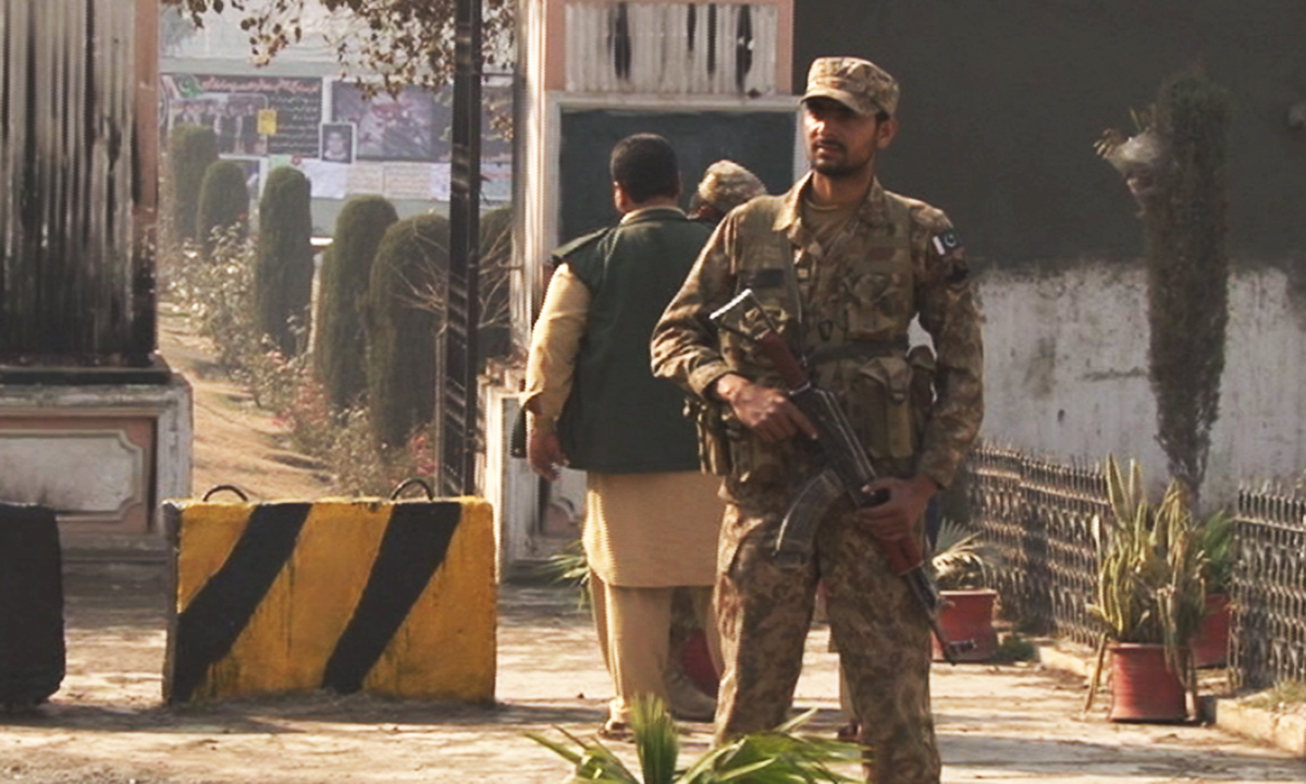 A security official on guard outside Army Public School. — Zahir Shah Sherazi