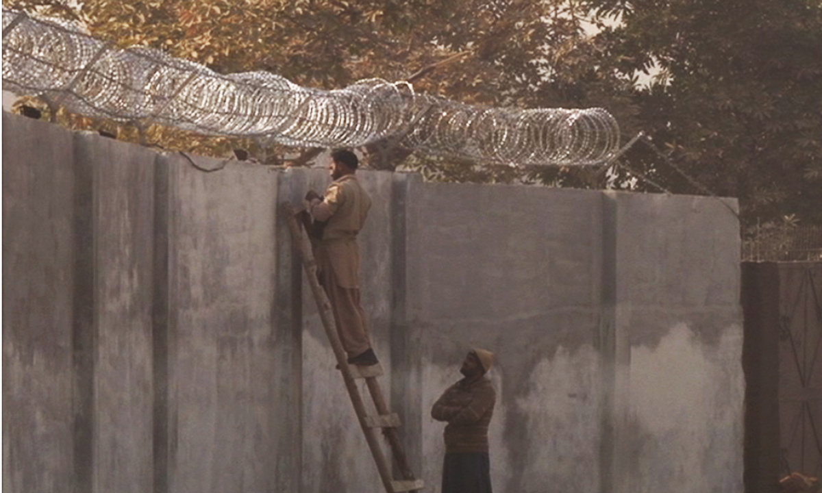 Barbed wires were seen across the walls surrounding the school.  — Zahir Shah Sherazi