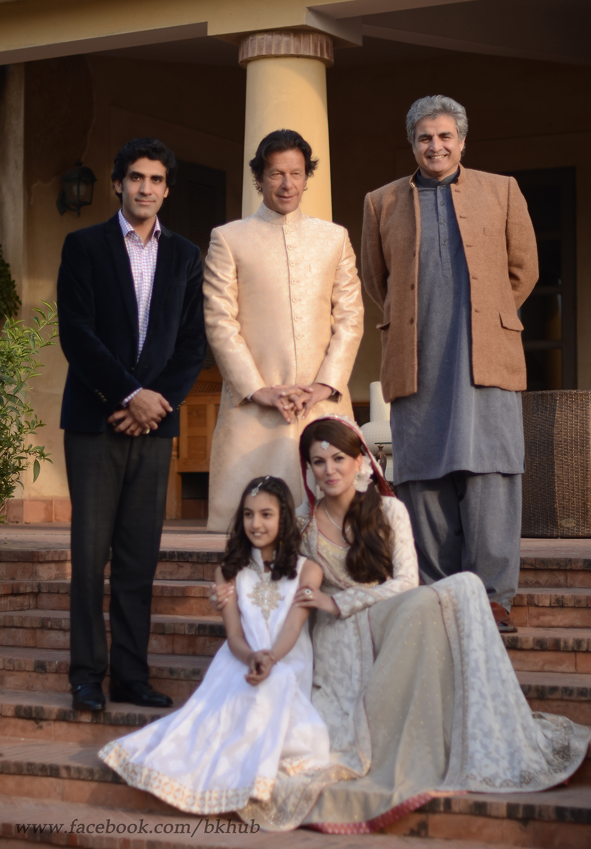 The couple pose with guests at the wedding.— Photo by Belal Khan