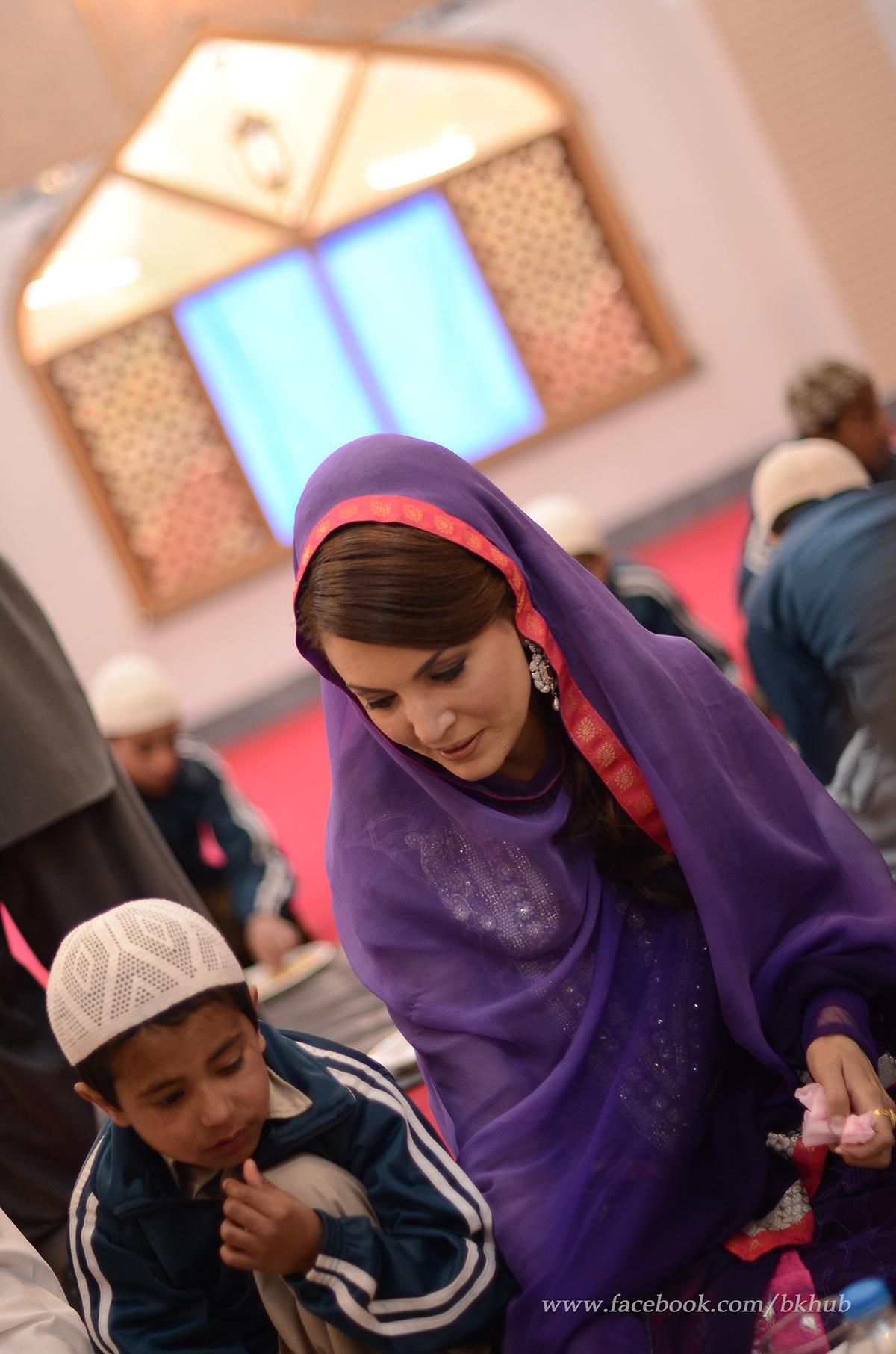 Reham Khan shares a meal with Madrassa children.— Photo by Belal Khan