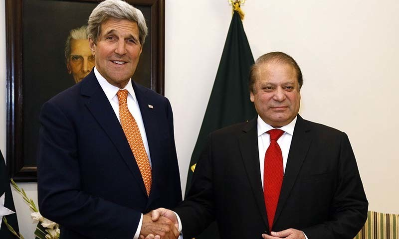 US Secretary of State John Kerry is greeted by Pakistan Prime Minister Nawaz Sharif shortly after arriving in Islamabad -AFP Photo