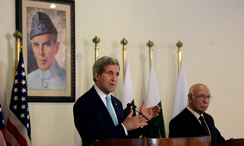 US Secretary of State John Kerry (L) speaks during a joint press conference with Sartaj Aziz, adviser to Nawaz Sharif on foreign affairs, at the Foreign Ministry in Islamabad on January 13, 2015. — AFP