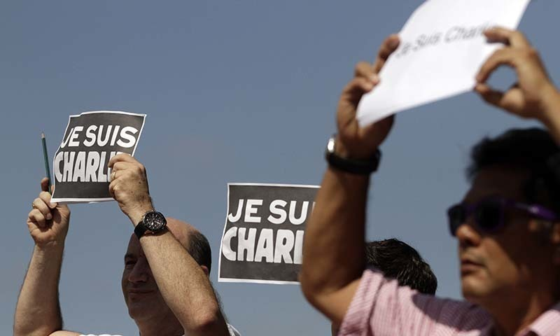 """Demonstrators hold """"Je Suis Charlie"""" (I am Charlie) signs during a gathering in solidarity with victims of the recent Paris terrorist attacks, at the Plaza de Francia in Panama City, Jan 12, 2015. — AP/File"""