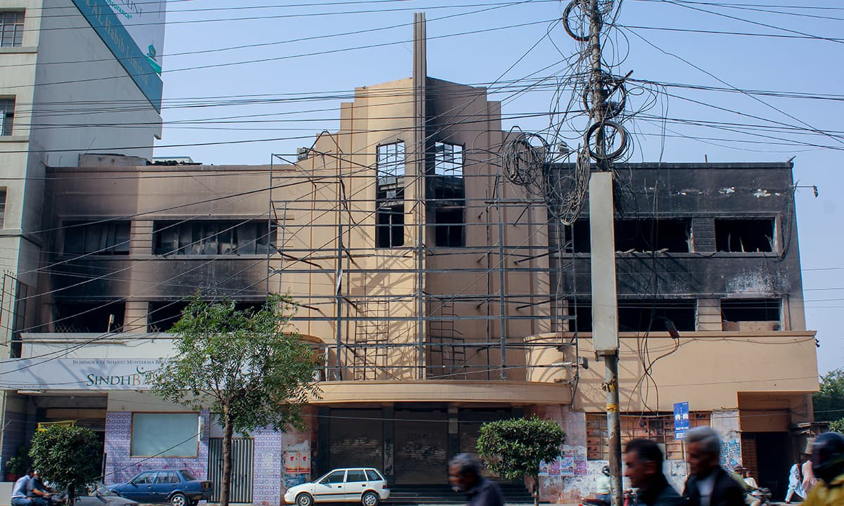 A full view of the burnt remains of Nishat Cinema. — Photo by Muhammad Umar