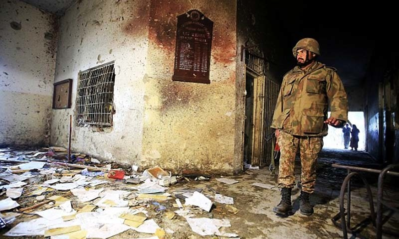 A soldier stands inside the Army Public School that was attacked by Taliban gunmen in Peshawar. — AFP/file