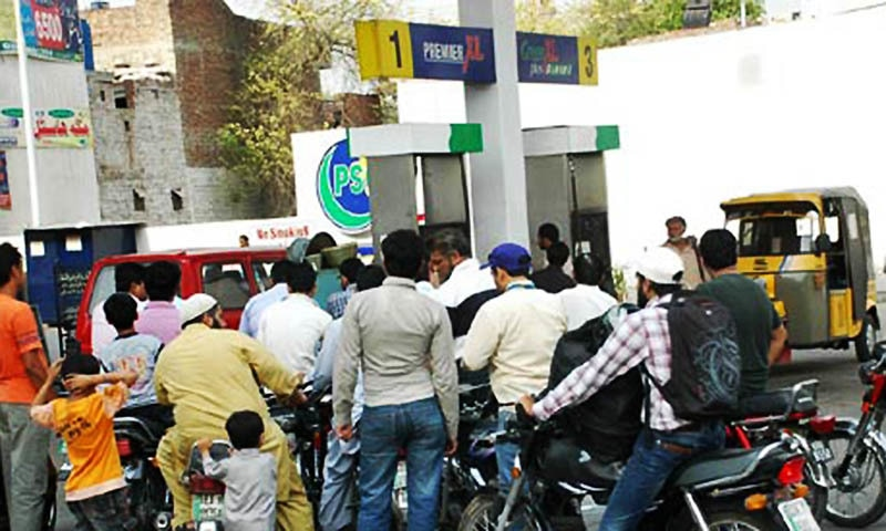 A large number of motorcyclists getting their fuel tanks filled from a petrol pump in Lahore.  — Online/file