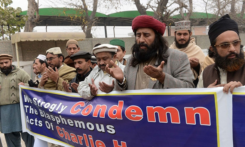 While last week's attack on Charlie Hebdo sparked global outrage, dozens of people Peshawar paid tribute on January 13 to the brothers who carried out the murders. -  AFP PHOTO