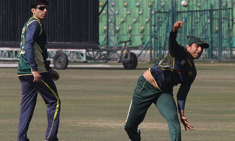 Younis Khan, right, throws the ball during a fielding drill at Gaddafi Stadium in Lahore, Pakistan. — AP