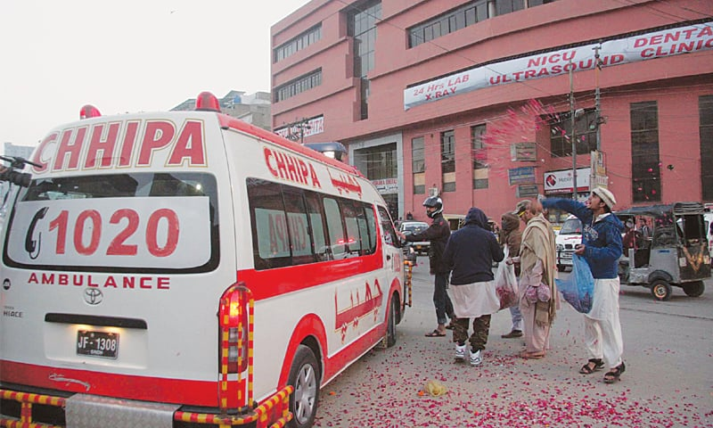 An ambulance shifting the body of a militant after his hanging at the Karachi central prison being showered with rose petals on Thursday.—PPI