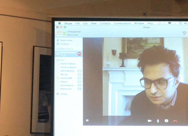 The filmmaker chatted with the audience over Skype. - Photo by author.