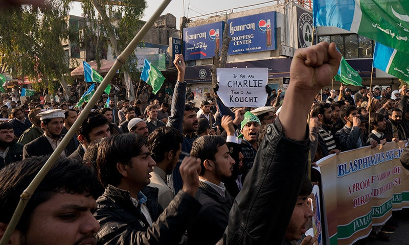Supporters of Jamaat-i-Islami rally to protest against French satirical magazine Charlie Hebdo in Islamabad. — AFP