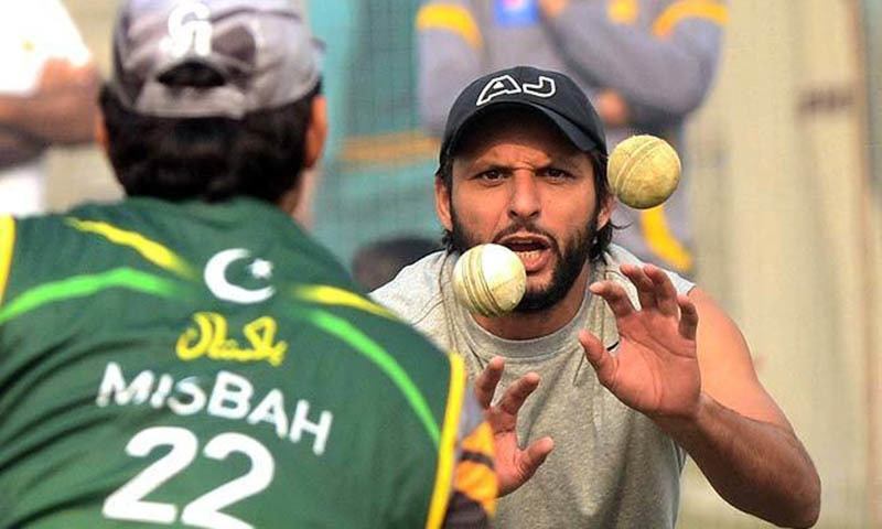 Shahid Afridi and MIsbah-ul-Haq in a give-and-take fielding session. —AFP/File