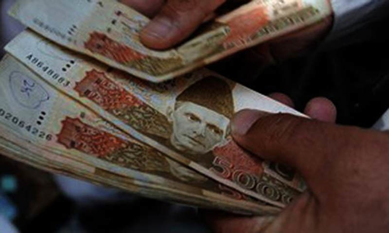 Currency notes of Rs5,000 could be seen in this picture. — AFP/File