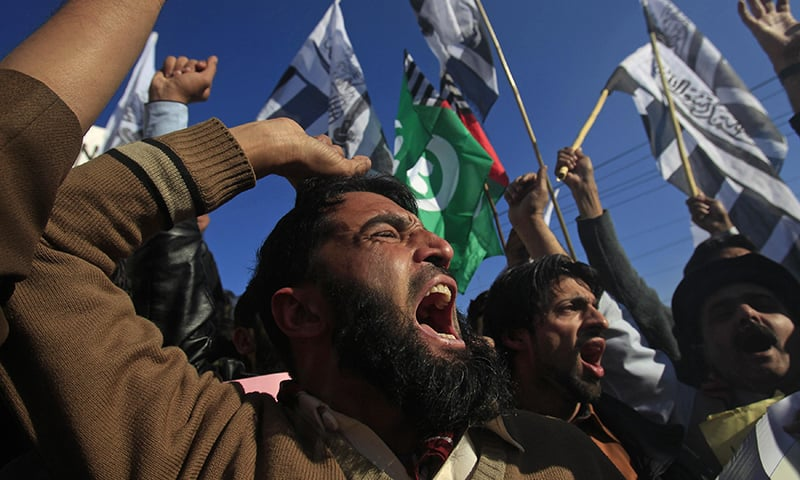 Supporters of religious groups protest against satirical French weekly newspaper Charlie Hebdo in Peshawar.  — Reuters