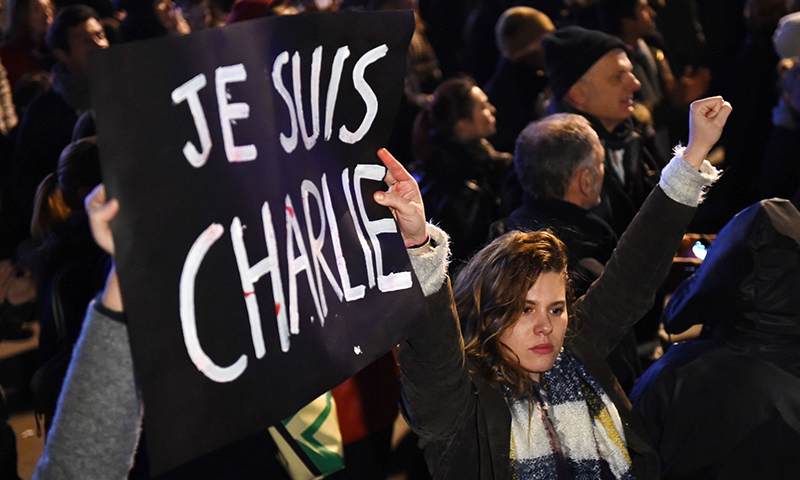 In this photo, a woman is seen protesting in favour of Charlie Hebdo in Paris. — AFP/File