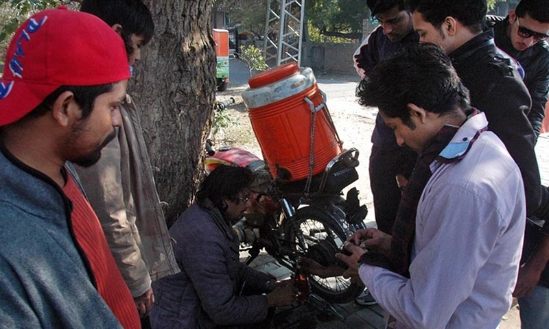 Man getting the benefit of petrol shortage at Ferozpur Road, seen selling 300 ml petrol bottle for Rs100. — Online