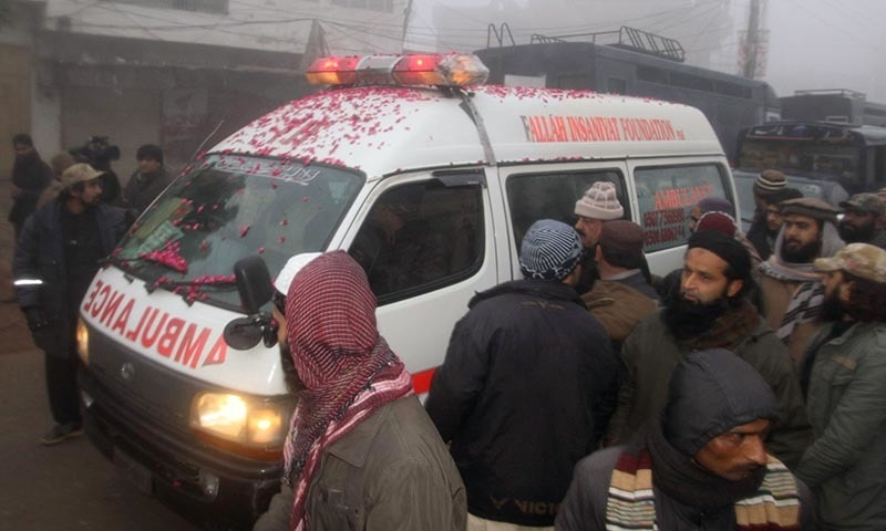An ambulance, carrying the body of an executed prisoner and pictured with rose petals over its roof and windshield, departs the central jail in Multan on January 7, 2015. — AFP