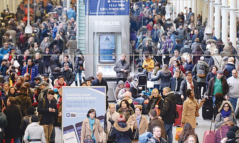 LONDON: Travellers wait for trains at St Pancras Station in UK's capital when Eurostar services were affected by fresh problems as the service attempted to get back to normal after a fire left thousands of passengers stranded on either side of the Channel, on Sunday.—AP