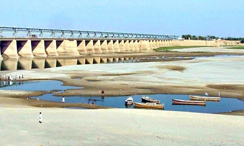 File photo shows fishermen's boats lie stranded in small pool of water in the River Indus at Hyderabad.— APP/File