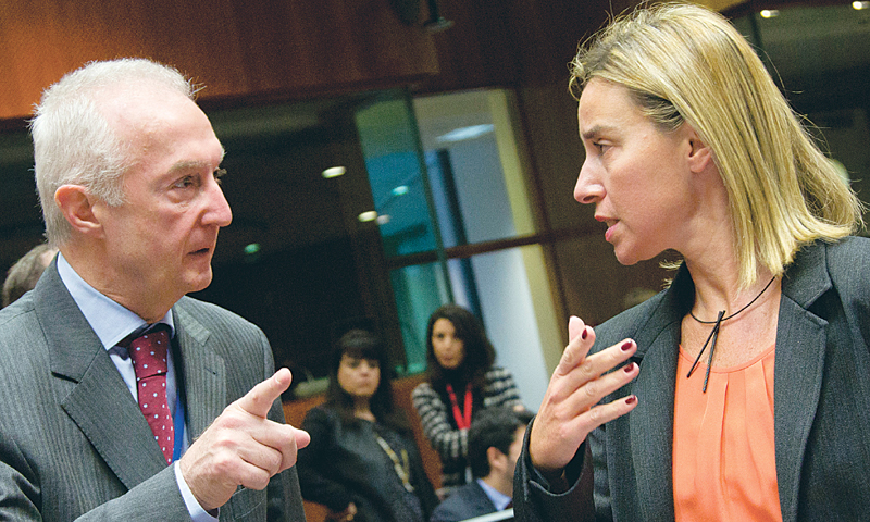 Brussels: EU Counter-Terrorism chief Gilles de Kerkhove (left) gestures while speaking with European Union High Representative Federica Mogherini during a meeting of EU foreign ministers here on Monday.—AP