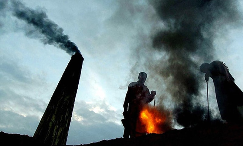 Labourers work at a brick kiln near Lahore. Open burning, vehicles, factories and power generation contribute significantly to the air pollution in Lahore.