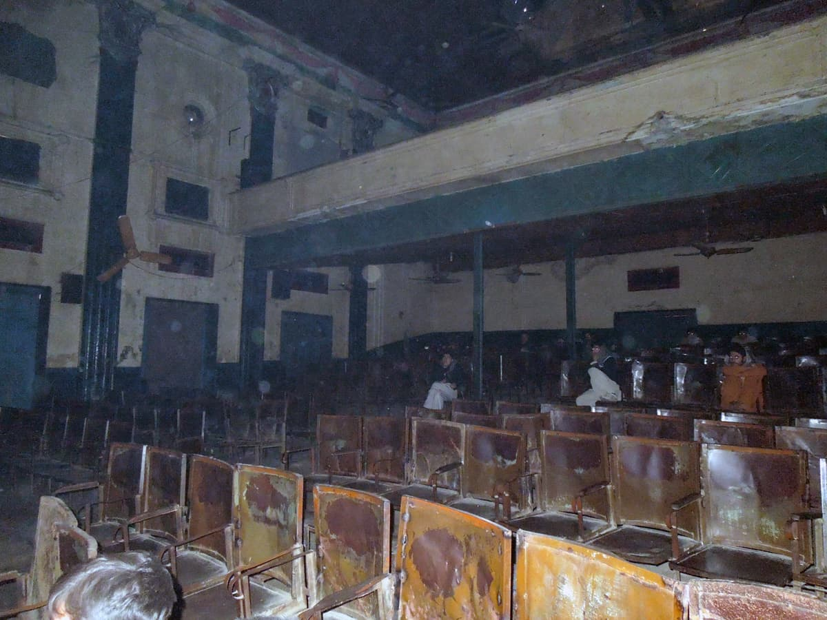 Less than a dozen spectators watch films in the dilapidated old screening room. — Photo by Shiraz Hassan