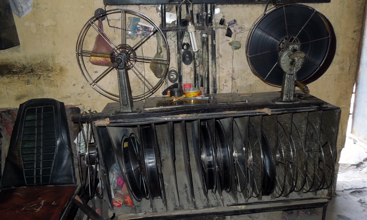 A rack with film reels and records in the projection room.  — Photo by Shiraz Hassan