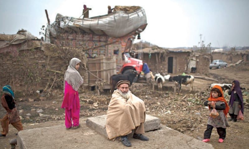 An elderly Afghan man sits outside is mud house in the outskirts of Islamabad. – AP/File