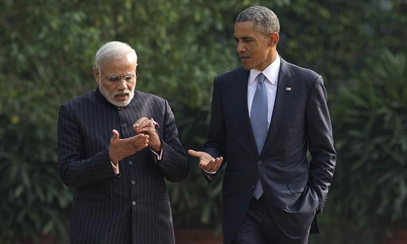 President Barack Obama talks with Indian Prime Minister Narendra Modi, left, in the gardens of the Hyderabad House in, New Delhi, India, Sunday, Jan. 25, 2015. — AP