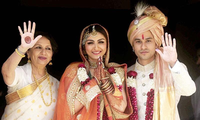 Indian Bollywood veteran actress Sharmila Tagore (L) poses during the wedding of Soha Ali Khan (C) and Kunal Khemu (R) in Mumbai on January 25, 2015. — AFP