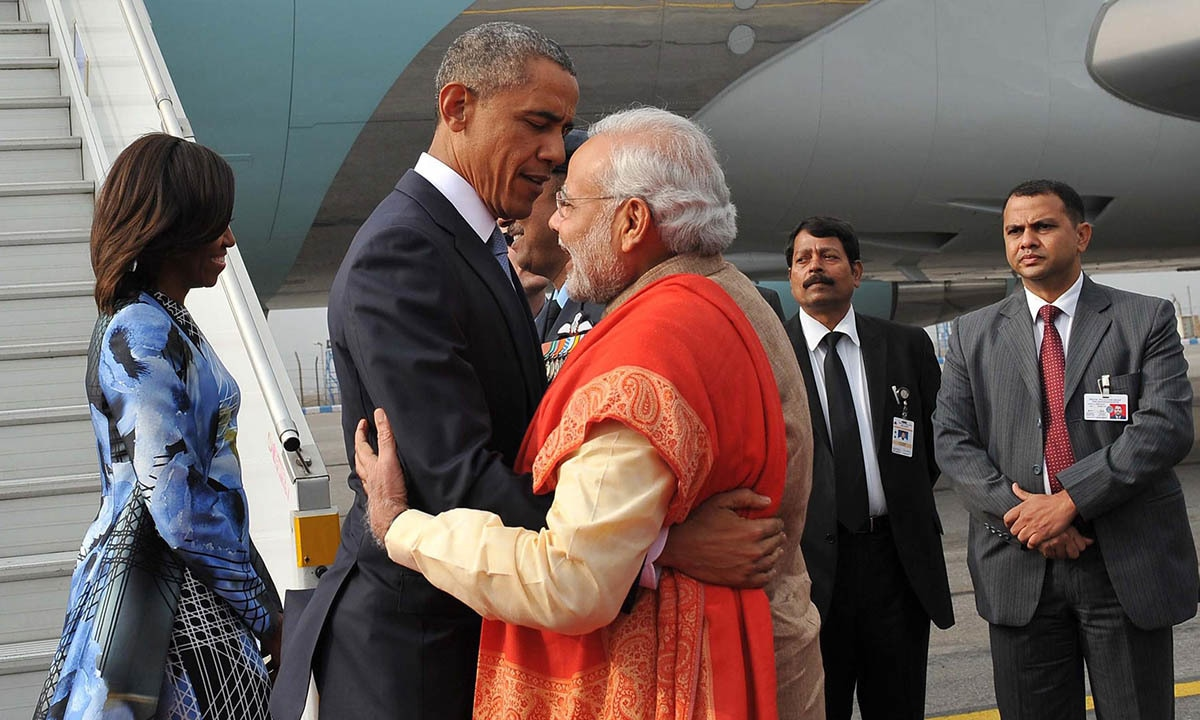 obama s to of handshakes and hugs world com in this handout photograph released by the press information bureau pib on 25