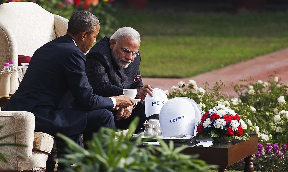Indian Prime Minister Narendra Modi (R) and US President Barack Obama sit and talk in the gardens between meetings at Hyderabad House in New Delhi on January 25, 2015. — AFP