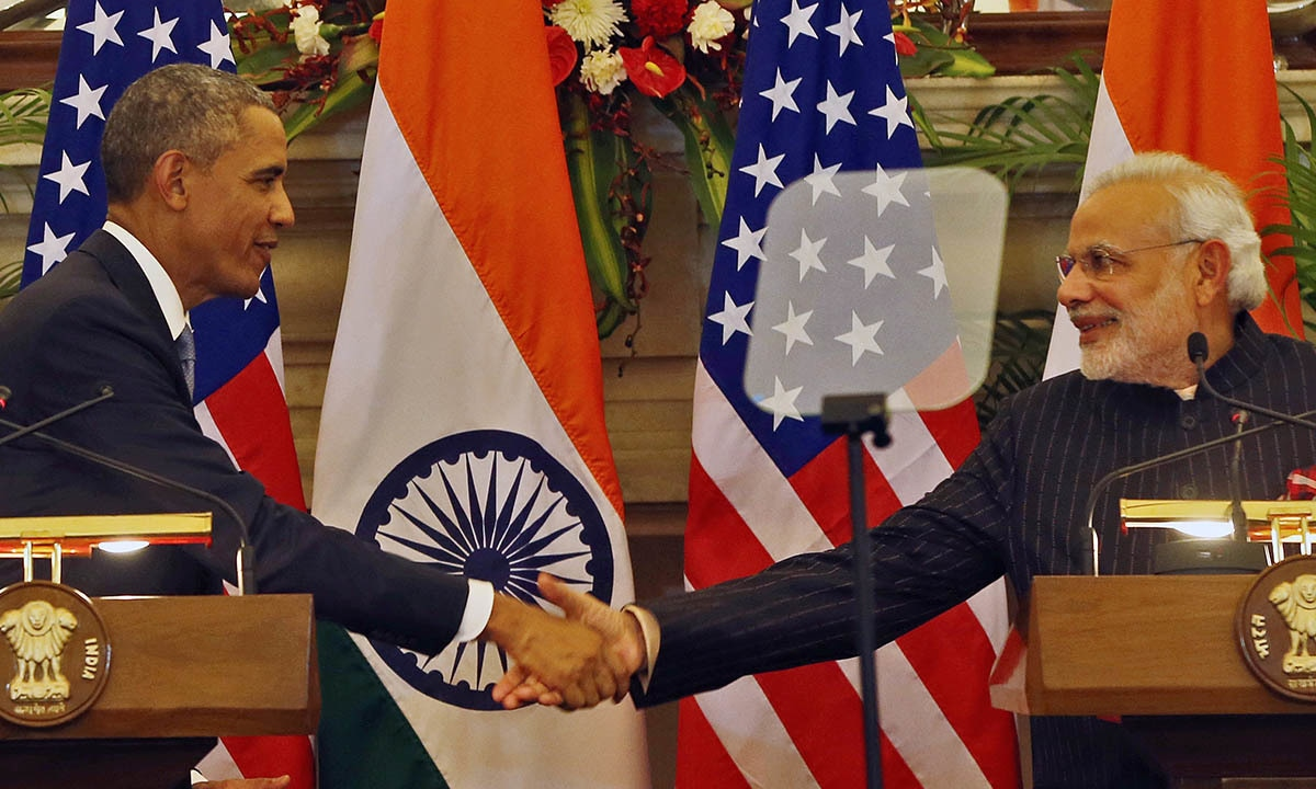 US President Barack Obama, left and Indian Prime Minister Narendra Modi shake their hands after they jointly addressed the media after their talks, in New Delhi, India, Sunday, Jan. 25, 2015.  — AP