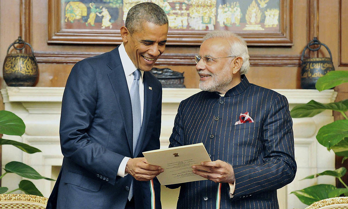 India's Prime Minister Narendra Modi (R) presents a reproduction of telegram sent by US to the Indian Constituent Assembly in 1946, to US President Barack Obama during their meeting in New Delhi January 25, 2015. — Reuters