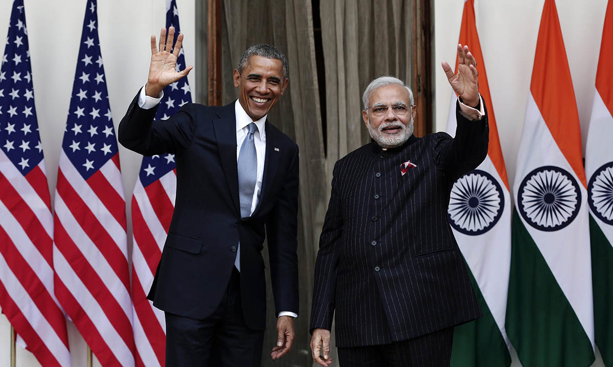 US President Barack Obama and India's Prime Minister Narendra Modi (R) wave during a photo opportunity ahead of their meeting at Hyderabad House in New Delhi January 25, 2015. — Reuters