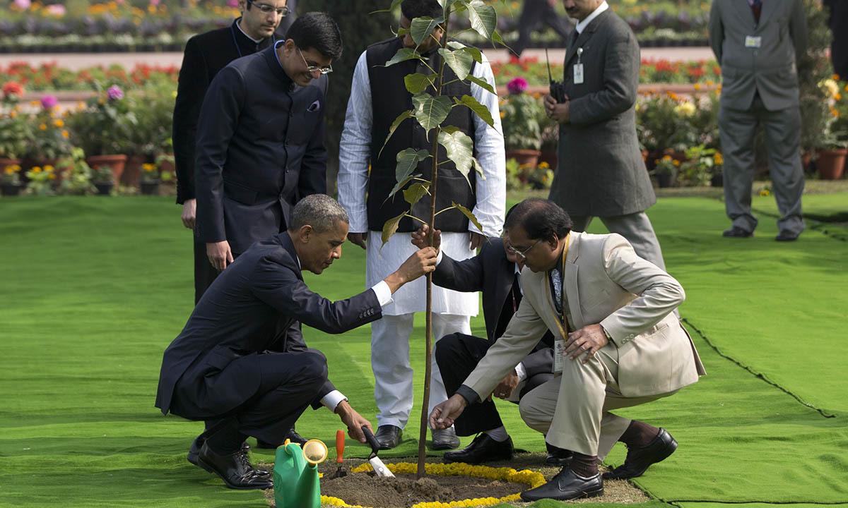 President Barack Obama, left, participates in a tree planting ceremony at the Raj Ghat Mahatma Gandhi Memorial, New Delhi, India, Sunday, Jan. 25, 2015. — AP