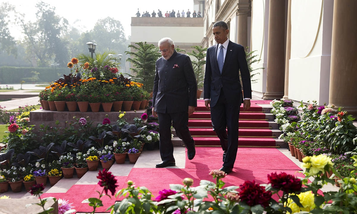 President Barack Obama walks with the Indian Prime Minister Narendra Modi to the gardens of the Hyderabad House in, New Delhi, India, Sunday, Jan. 25, 2015. — AP