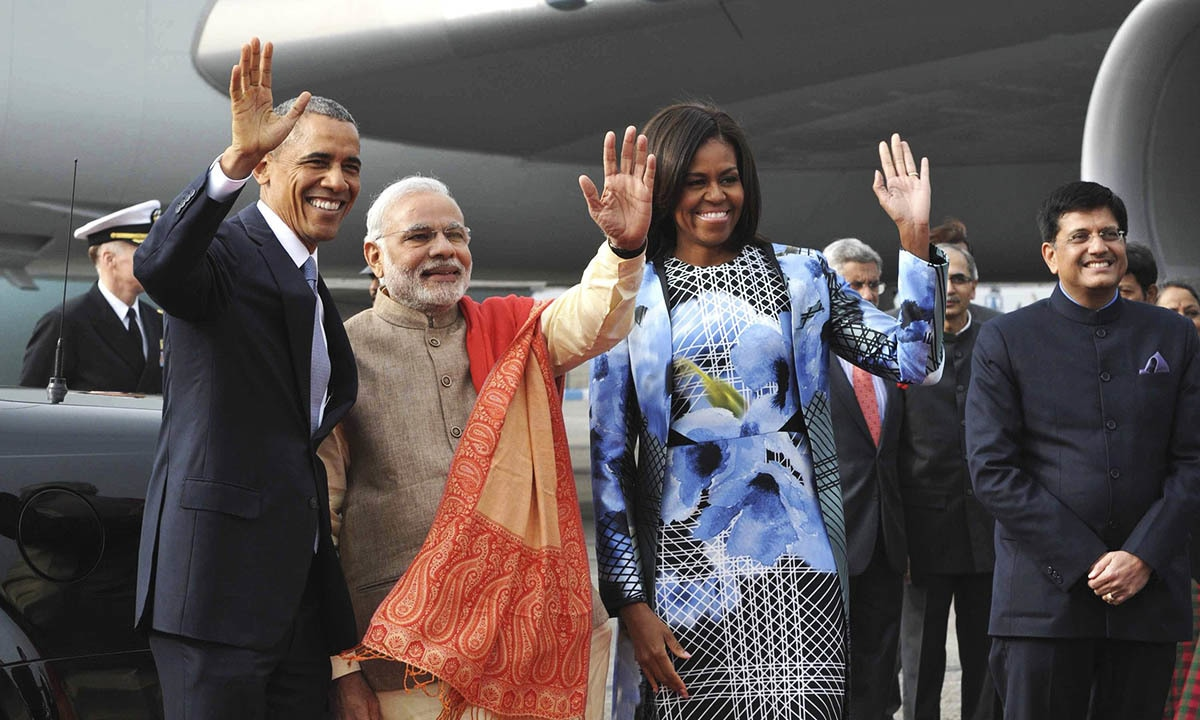 US President Barack Obama (L), India's Prime Minister Narendra Modi (2nd L) and first lady Michelle Obama wave their hands at Air Force Station Palam in New Delhi January 25, 2015.— Reuters